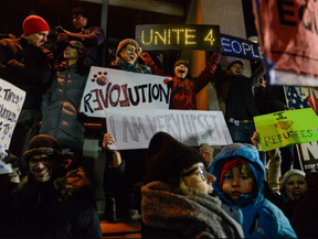 Protestors rally during a demonstration against the Muslim immigration ban at John F. Kennedy International Airport. (Stephanie Keith, Getty Images)