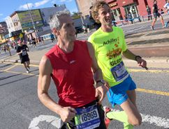 Ary Tsotras (left) runs with Achilles Canada guide Rob Whitmill. (Photo submitted)
