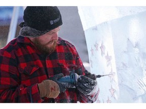 Nathan McKeough carves an ice sculpture on the Ottawa City Hall grounds in preparation for Winterlude, January 31, 2017. JEAN LEVAC / POSTMEDIA NEWS