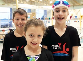 From left, Sarnia Y Rapids 1 swim team members Darius Landon, 10, Ali Page, 9, and Lauren Armstrong, 9, all finished first at the under-12 celebration meet in London this past Saturday. The Sarnia team had 11 swimmers at the meet. (Handout/Sarnia Observer/Postmedia Network)