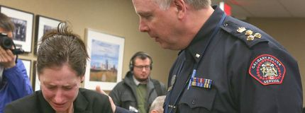 Jen Ward is comforted by Calgary police chief Roger Chaffin