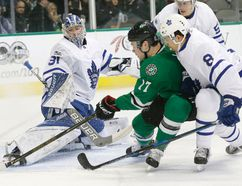 Stars centre Devin Shore (17) scores a goal against Maple Leafs goalie Frederik Andersen while Leafs defencemen Connor Carrick (8) and Jake Gardiner (51) defend during first period NHL action in Dallas on Tuesday, Jan. 31, 2017. (LM Otero/AP Photo)