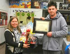 Kim Doucet, left, presents the 'Ashley's Youth of the Year Award' to Tilbury District High School student Konar Jones, for his efforts in helping others. (Handout/Chatham Daily News)