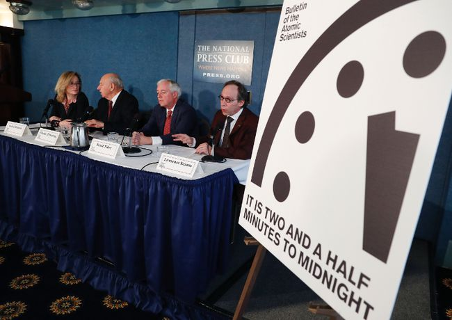 From left, Rachel Bronson, executive director and Publisher of the Bulletin of the Atomic Scientists; Thomas Pickering, co-chair of the International Crisis Group; David Titley, a nationally known expert in the field of climate, the Arctic, and national security; and Lawrence Krauss, theoretical physicist, chair of the Bulletin of the Atomic Scientists Board of Sponsors, participate in a news conference the at the National Press Club in Washington, Thursday, Jan. 26, 2017, announcing that the Bulletin of the Atomic Scientist have moved the minute hand of the Doomsday Clock to two and a half minutes to midnight. (AP Photo/Carolyn Kaster)