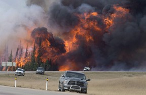 A giant fireball is seen as a wild fire rips through the forest 16 km south of Fort McMurray, Alberta on highway 63 Saturday, May 7, 2016.