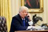 U.S. President Donald Trump speaks on the phone with Prime Minister of Australia Malcolm Turnbull in the Oval Office of the White House in Washington Jan. 28, 2017. (AP Photo/Alex Brandon)