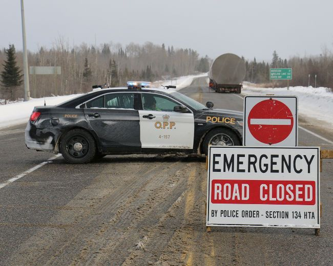 OPP at the scene of a crash on Highway 11 near Monteith that killed an 11-year-old girl from Burlington riding a snowmobile on Wednesday, Feb. 1, 2017. (LEN GILLIS/Postmedia Network)