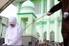 A 20-year old Muslim woman gets caned after being caught in close proximity with her boyfriend in Banda Aceh on Oct. 31, 2016. Aceh is the only province in the predominantly Muslim country that applies Sharia law, and public canings for breaches of Islamic code happen on a regular basis and often attract huge crowds. (GETTY IMAGES)