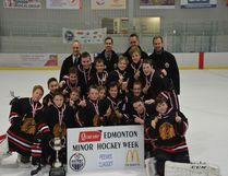 The Beaumont peewee AA Braves celebrate after winning the Minor Hockey Week tournament earlier this year.