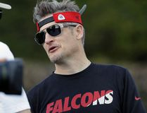 Falcons general manager Thomas Dimitroff (right) visits during a practice for Super Bowl 51 in Houston on Wednesday, Feb. 1, 2017. (Eric Gay/AP Photo)
