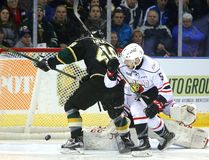 Sam Miletic of the Knights is tied up by Sean Durzi of the Owen Sound Attack keeping Miletic from getting his stick on a rebound from Attack goaltender Michael McNiven on Friday February 3, 2017 at Budweiser Gardens. (MIKE HENSEN, The London Free Press)