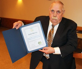 Plympton-Wyoming Mayor Lonny Napper holds up the community appreciation award for the late Keith Murray at the Camlachie Community Centre on Saturday, Feb. 4, 2017 in Camlachie, Ont. Napper, who was close friends with Murray before he died in a plane crash in September 2016, accepted the award his behalf.