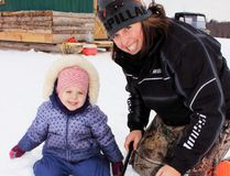 Sean Chase/Daily Observer Three-year-old Grace Graham joins her grandmother, Linda Roy, for a day of ice fishing on Muskrat Lake in Cobden. The annual Kids and Cops Go Fishing derby saw 101 entries.