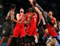 Nets centre Brook Lopez (11) lands a basket as he goes over a group of Raptors defenders including Jonas Valanciunas (17) and DeMarre Carroll (5) during first half NBA action in New York on Sunday, Feb. 5, 2017. (Kathy Willens/AP Photo)