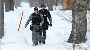 Members of the Winnipeg Police Service tactical unit walk down Midwinter Avenue between Brazier Street and Levis Street in the Elmwood area of Winnipeg on Sun., Feb. 5, 2017. Police tweeted that they were investigating a serious incident there. On Monday, Feb. 6, 2017, Winnipeg Police Service announced that six individuals were facing drug related charges after police responded to the 200 block of Midwinter Avenue on Sunday afternoon regarding a male possibly armed with a gun. Kevin King/Winnipeg Sun/Postmedia Network