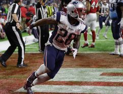 Patriots' James White celebrates after scoring the winning touchdown during overtime of Super Bowl 51 against the Falcons in Houston on Sunday, Feb. 5, 2017. (Elise Amendola/AP Photo)
