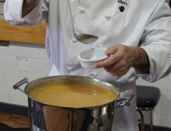 Merv Russell, a chef and instructor at Collège Boréal, served up a green apple parsnip soup for hungry participants at the Empty Bowls fundraiser that was held at Northern College on Sunday. He was joined by a panel of other local chefs who served their finest creations to 150 attendees in handmade pottery bowls in support of food security initiatives in Timmins.