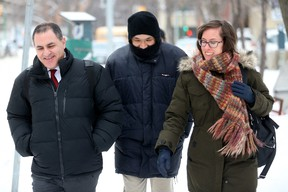 Will Baker, formerly known as Vince Li, leaves the Law Courts building in Winnipeg, after his annual criminal code review board hearing with his lawyer Alan Libman, left, Monday, February 6, 2017. A schizophrenic man who beheaded and cannibalized a fellow passenger on a Greyhound bus could know later this week whether he will be granted his freedom. THE CANADIAN PRESS/Trevor Hagan
