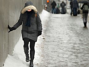 Walking on the sidewalk, or close to it, during winter weather.
