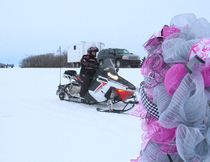"""The Prairie Women On Snowmobiles rode down a """"Pink Mile""""  and past a Breast Cancer wreath while heading into Star City, the final stop on their Mission 2017. Please see related story and photos on Page 7 as well as at www.melfortjournal.com"""