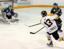 Josh Bly takes a shot at Mustangs goalie Evan Plotnik. This one didn't make it in the net but the Nipawin Hawks went on to win 6-2.