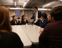 Attorney General Yasir Naqvi talks with participants of a town hall meeting about ticket sales in Ontario during a stop in Kingston on Tuesday. (Elliot Ferguson/The Whig-Standard)