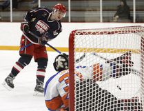 Cochrane Generals' Connor Rendell scores a goal on High River Flyers goaltender Billy Cawthorn during an HJHL game on Saturday. Rendell recorded a hat-trick in the 7-5 win.