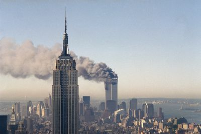 """FILE - In this Sept. 11, 2001 file photo the twin towers of the World Trade Center burn behind the Empire State Building in New York after terrorists crashed two planes into the towers causing both to collapse. The government is preparing to release a once-classified chapter of a congressional report about the attacks of Sept. 11, that questions whether Saudi nationals who helped the hijackers with things like finding apartments and opening bank accounts knew what they were planning. House Minority Leader Nancy Pelosi said Friday July 15, 2016, that the release of the 28-page chapter is """"imminent.� (AP Photo/Marty Lederhandler) ORG XMIT: NYR107"""