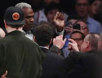 Former New York Knicks and Toronto Raptors player Charles Oakley exchanges words with a security guard during the first half of an NBA basketball game between the New York Knicks and the LA Clippers Wednesday, Feb. 8, 2017, in New York. (AP Photo/Frank Franklin II)