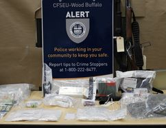 ALERT displays some of the drugs, weapons and cash seized by police in Fort McMurray, Alta. on Jan. 19, 2017. Supplied Image/ALERT