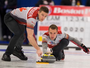 Skip Brendan Bottcher, throws a rock as second Bradley Thiessen sweeps at the 2017 Alberta Boston Pizza Cup men's curling championship in Westlock,on Wednesday February 8, 2017.