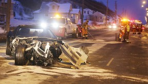 Crews clean up after a four-vehicle collision on the Kingsway in Sudbury, Ont. on Thursday February 9, 2017. The who drover this Corvette was sent to the pen on Wednesday. Gino Donato/Sudbury Star/Postmedia Network