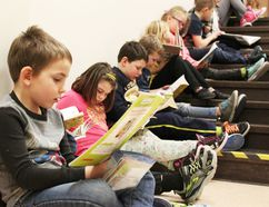 PAUL KRAJEWSKI HIGH RIVER TIMES/POSTMEDIA NETWORK. Students read quietly while they line the halls of Spitzee Elementary School in High River, Alta., on Jan. 25, 2017, to create a reading chain in recognition of Family Literacy Week.