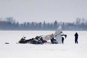 Transport Safety Board and RCMP investigators work at the scene of a fatal plane crash 11km outside of Brunkild, Man., on Friday, February 10, 2017. Two men were killed in the crash. THE CANADIAN PRESS/John Woods