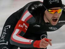Canada's Vincent De Haitre and Ivanie Blondin are seen in the combination shot, competing during the men's 1000 metre race and women's 5,000 metre race, respectively, of the ISU world single distances speed skating championships at Gangneung Oval in Gangneung, South Korea, Saturday, Feb. 11, 2017. (AP Photo/Ahn Young-joon/Atsushi Tomura/Getty Images)