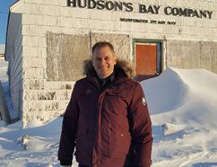 Timmins Police DARE officer, Rick Lemieux in front of an old Hudson's Bay Company outpost in Nunavut during his trip to the territory to do DARE program training there.