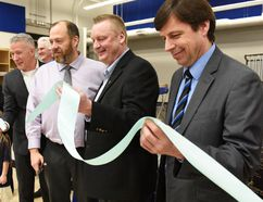 Deputy Minister for Education Curtis Clarke (left), Catholic School Board chair Eldon Wyant, Grande Prairie-Wapiti MLA Wayne Drysdale, and Grande Prairie-Smoky MLA Todd Loewen cut the ribbon during the grand opening of the St. Catherine Catholic School on Friday in Grande Prairie. (Svjetlana Mlinarevic/Grande Prairie Daily Herald-Tribune/Postmedia Network