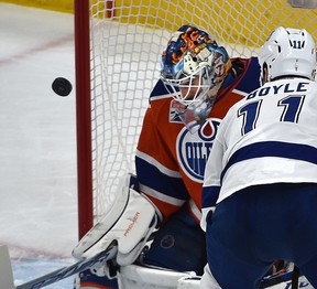 Edmonton Oilers goalie Cam Talbot makes a save on Tampa Bay Lightning Brian Boyle at Rogers Place in Edmonton on Dec. 17, 2016. (Ed Kaiser)