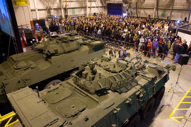 A $404-million federal deal to upgrade LAVIII armoured vehicles like these, above, will secure 250 jobs at London's General Dynamics plant and reassure workers nervous about slowing production, company and union officials say. (Free Press file photo)