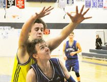 Jack Dixon of the Mitchell District High School (MDHS) junior boys basketball team looks to go up for a basket but is impeded by the defence of this St. Michael opponent during action from the Huron-Perth quarter-final last Wednesday, Feb. 8, a 37-21 loss. ANDY BADER/MITCHELL ADVOCATE