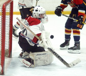 Wallaceburg Midget AE goalie Hunter Shipman makes a blocker save against Mt. Brydges on Friday, February 9, at Wallaceburg Memorial Arena. Mt. Brydges won the game 6-0 and won again on Sunday to take a 4-0 points lead in their OMHA quarterfinal six-point series.