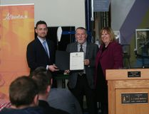 Alberta's Minister of Energy Margaret McCuaig-Boyd (right) officially declared February 13, 2017 to be Oil and Gas Celebration Day in Alberta. McCuaig-Boyd was joined by the Canadian Association of Oilwell Drilling Contractors President Mark Scholz (left) and the Leduc/Devon Oilfield Historical Society President Tim Hawkins (middle). The announcement was made at the Leduc #1 Energy Discovery Centre. Alex Boates/Devon Dispatch