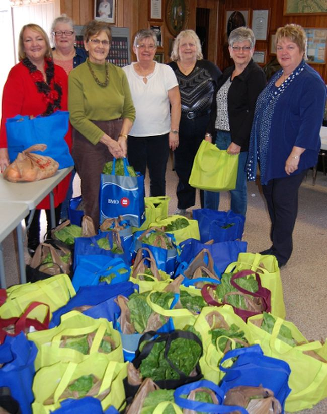 <p>Iroquois' Green Food Box site lead volunteer, Dianne Fawcett (not pictured), invited South Dundas Mayor Evonne Delegarde, right, to join Fawcett's volunteer crew Wednesday morning at the Iroquois Legion, to celebrate the program's first anniversary. From left are Sandi Decker, Lorraine Bottan, Ann Banford, Faye McCurdy, Anne Presley, Charlotte Duncan, and Delegarde. </p><p> Handout/Cornwall Standard-Freeholder/Postmedia Network