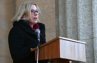 Rochelle Squires, minister of sport and minister responsible for the status of women, speaks during a ceremony at the Manitoba Legislative Building on Mon., Feb. 13, 2017 to recognize the Chemo Savvy dragon boat racing team's 20th anniversary and to promote cancer awareness. The building's pillars were bathed in pink light, which is how they'll stay all week. Kevin King/Winnipeg Sun/Postmedia Network