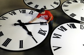 Dan LaMoore sizes hands for an 8-foot diameter silhouette clock at Electric Time Co., in Medfield, Mass.