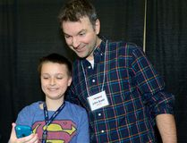 Former NHL tough guy John Scott poses for a selfie taken by Aiden Anderson during a reception for kids from the Thames Valley Children's Centre at the Western Fair Agriplex on Monday. (MORRIS LAMONT, The London Free Press)