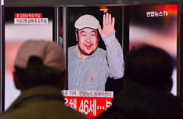 People watch a television showing news reports of Kim Jong-Nam, the half-brother of North Korean leader Kim Jong-Un, at a railway station in Seoul on February 14, 2017. Kim Jong-Nam, the half-brother of North Korean leader Kim Jong-Un has been assassinated in Malaysia, South Korean media reported on February 14. / AFP PHOTO / JUNG Yeon-JeJUNG YEON-JE/AFP/Getty Images