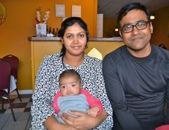 Sharif Rahman with his wife, Shayela, and their daughter, Shaiqua in their restaurant, The Curry House, in downtown Owen Sound Monday. The Rahmans held two dinners and donated the $1,400 in proceeds to the Canadian Foodgrains Bank's Harvest for Hunger project. Sharif Rahman hopes to expand the dinners this year. (Scott Dunn/The Sun Times, Owen Sound)