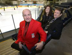 Peter Inch, Chair Board of Governors Curling Canada, Cheryl Finn, director Tourism London, and Ted Smith, vice-chair Continental Cup host committee, sit in the Western Fair Sports Centre where the World Financial Continental Cup will be held in 2018. (MORRIS LAMONT, The London Free Press)