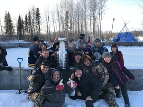 Toronto Ward 6 Etobicoke-Lakeshore city councillor Mark Grimes and residents of Sandy Lake First Nations, located about 600 kilometres north of Thunder Bay, celebrate with the Stanley Cup recently. (SUBMITTED/PHOTO)